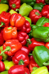 Red, green and yellow sweet bell peppers natural background.