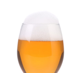 Closeup of beer glass with foam.