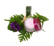Cosmetic pink cream with herbs and flowers