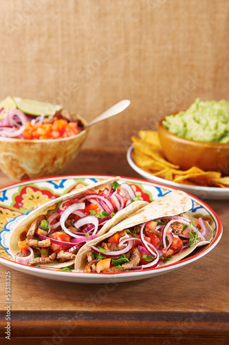 Beef meat and vegetables Mexican tacos