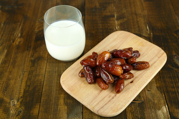 Conceptual photo of Ramadan food:dates palm, milk in glass