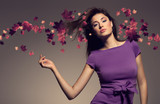 autumn picture of young beautiful woman wearing purple dress