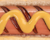 Close up of hotdog with mustard.