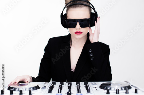 Beautiful sexy disc jockey at her deck