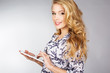 pretty young woman holding tablet pc