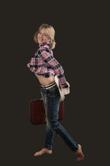 Beatiful young girl model in blue jeans with bag and white cap