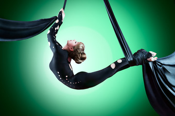 Beautiful dancer on aerial silk, aerial contortion, aerial ribbo