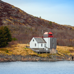 Old Norwegian Lighthouse stands on the seacoast