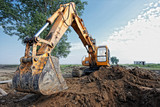 excavator digs a hole - 59324128
