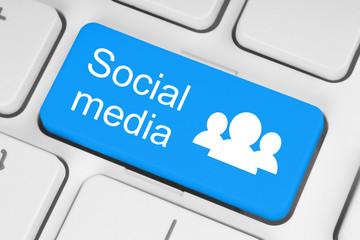 Blue social media keyboard button close-up .