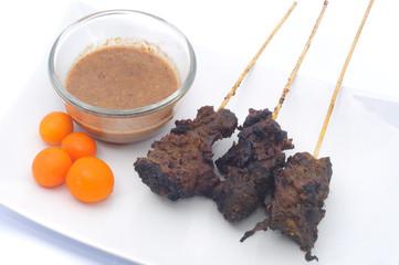 Bone satay served with delicious peanut gravy