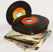 pile of 45 RPM vinyl records used and dirty even - 59325909