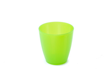 Green plastic cup isolated on white