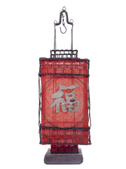 Standing red oriental lantern isolated over white