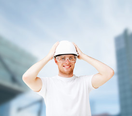 male architect in helmet with safety glasses