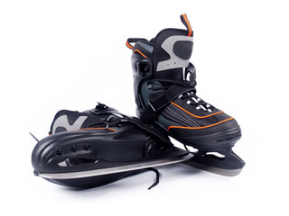 Pair of man ice hockey skates over a white background