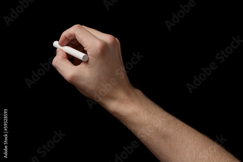 adult man hand with chalk to write something