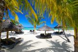Lounge chairs with umbrellas on white sand beach, Mauritius