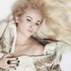 Beautiful blond woman in fur.tender sexy girl.winter.square