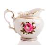 Retro porcelain teapot on a white isolated background