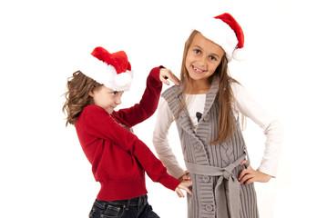 girls in santa hats having fun playing around
