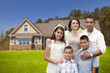 Young Hispanic Family in Front of Their New Home