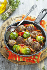 Meatballs with vegetables in tomato sauce
