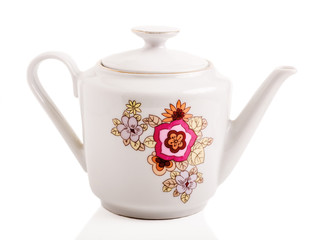 Retro porcelain teapot on a white isolated