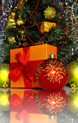 image of a decorated Christmas tree and gift boxes