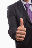 Mid section of a businessman gesturing thumbs up