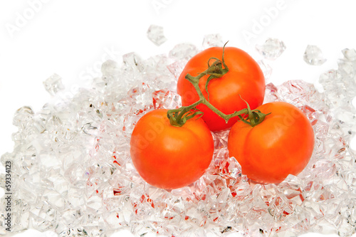 Fresh tomato on ice
