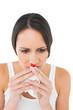 Brunette woman having a nose bleed