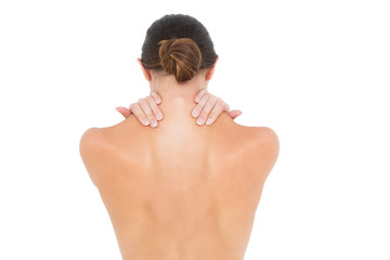 Close-up rear view of a topless woman with shoulder pain