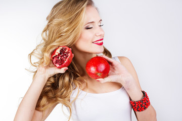 beautiful woman with pomegranates in her hands