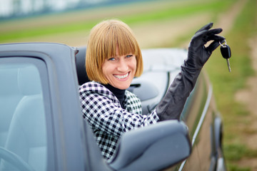Middleaged woman with her new car
