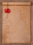 Parchment with wax seal stamp on burlap