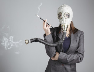 Woman in a gas mask with a cigarette