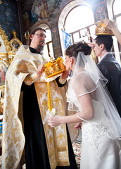 bride kissing golden crown on orthodox wedding ceremony
