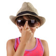 Little girl in a straw hat and sunglasses