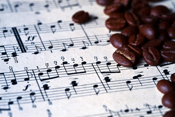 Musical score with coffee beans on it