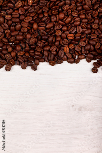 Coffee beans as border on white