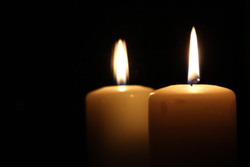 Lighted candles on a black background