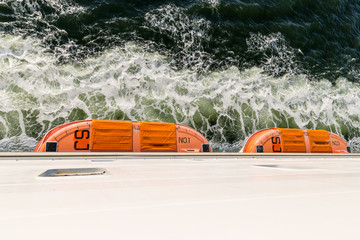 Top view of lifeboats at a big ferry between Germany and Sweden
