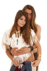 couple long hair man behind Native American woman looking