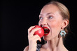 Pretty redhead woman eating an apple