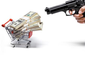 gun and shopping cart full of stacks of dollar bills