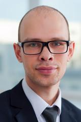 Closeup portrait of businessman with glasses
