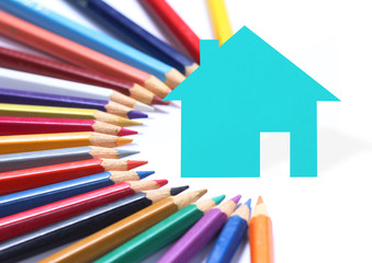Colored pencils and paper houses