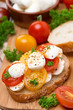 ciabatta with mozzarella and colorful cherry tomatoes, close-up