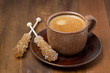 cup of coffee and caramel sugar on sticks